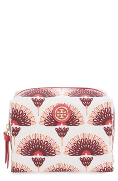 Carrying the beauty essentials in this beautiful floral-inspired cosmetic bag by Tory Burch.