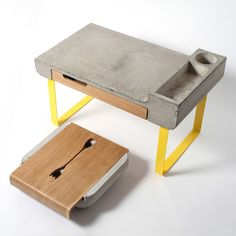 "A bed tray table ""Dobrostol"" also made of fibro-concrete. This table has several variants of using. At first, it's a bed tray table that we could use for the eating in a bed or by sitting on a sofa. Concrete Table, Concrete Furniture, Design Furniture, Bedroom Furniture, Bed Tray Table, Petites Tables, Industrial, Yanko Design, Design Moderne"