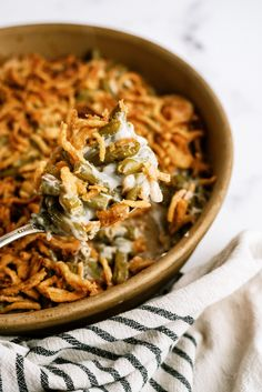 This easy Classic Green Bean Casserole with its crispy French onion top pairs perfectly with your Thanksgiving and Christmas dinner.