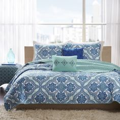 The Intelligent Design Lana Coverlet Set provides a modern take on bohemian chic. Printed on microfiber, this unique pattern features large medallions with intricate design work inside using bold blues and greens.