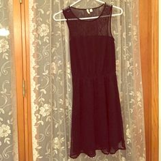 """BOGO Lace back and bottom dress Perfect little black dress-in great condition. Elastic waistband that hits mid torso. I am 5.7"""" and this is just long enough that if I bend over you can't see my bum unless I'm really bending  Frenchi Dresses"""