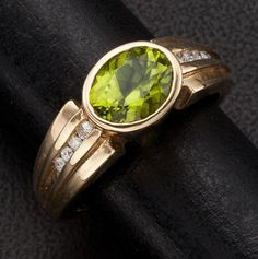 Peridot & Diamond Gold Ring  like new/old stock,14k yellow gold, 5.1 grams, peridot is approximately 7 mm x 9 mm, accented with small diamonds