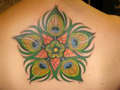 flower made of peacock feather watercolor tattoo on upper back for girls