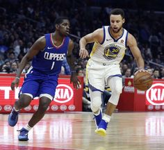 Golden State Warriors guard Stephen Curry dribbles by guard Jawun Evans during second half of an NBA basketball game in Los Angeles, Saturday, Jan. 6, 2018. Behind Curry's 45 points, the Warriors won 121-105. (AP Photo/Alex Gallardo)