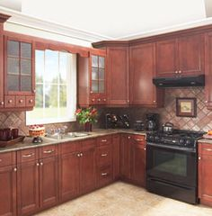 I like this color of wood. don't like backsplash. Would be better with stainless