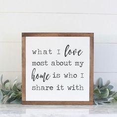 """What I Love Most About My Home Is Who I Share It With++ ABOUT THIS SIGN ++SIZE:13.5"""" tall and 13.5"""" wide with the frame(Custom sizes available)COLORS SHOWN:White background with black letteringFRAMING:Our signature Espresso stain is used on all of our signs(Custom frame colors available)Our frames have a depth of 1.5"""" inchesMATERIALS:We use only high quality birch wood for our signs, and finish them with our pine frames. Each sign is hand-painted and are recommended for indoor use…"""