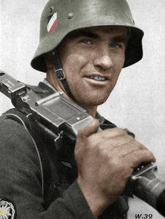 Holding an Mg-34 on his shoulder.