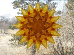 16 Point Gold Window Star with 8 Sided Yellow Star Suncatcher Waldorf Home Decor Sun Catcher Winter Spring Solstice Equinox. $18.00, via Etsy.