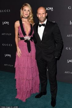 Loved up: Rosie Huntington-Whiteley and her handsome boyfriend Jason Statham made for a fashionable couple