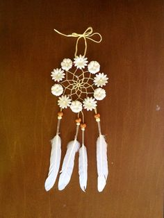 Dream Dens best seller! Handmade dream catcher with mocha suede lace exterior covered in white mulberry paper flowers. Clear beading accents decorate