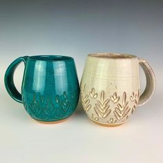 These handcrafted mugs are Wheel thrown and hand carved by Meredith at Fern Street Pottery. They are thrown in a red-brown Stoneware clay (not terracotta!) so they are durable and functional in addition to beautiful. #pottery #mug #ceramic #handcrafted #PotteryMug Pottery Mugs, Pottery Studio, Stoneware Clay, Handmade Pottery, North West, Hand Carved, Teal, Carving, Terra Cotta