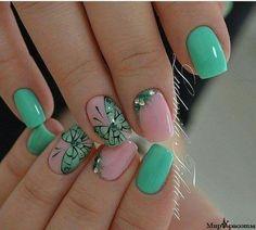 Pink and teal nail art.