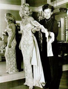 """Marilyn Monroe and hairstylist Gladys Rasmussen getting ready for the """"How To Marry A Millionaire"""" premiere in 1953."""