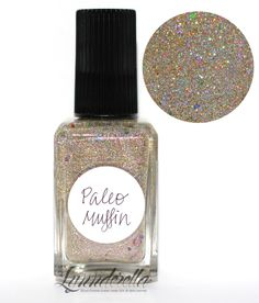 Lynnderella Limited Edition—Paleo Muffin is a blend of cool gold and silver holographic microglitters studded with assorted jewel-toned accents in a warm pink-shimmered clear base.