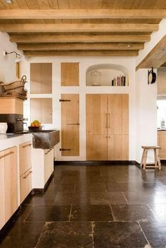 Belgian-style kitchen. Hello my Mother. Wood, already owns that clock & she is Belgian.