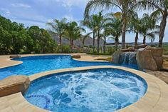 Tropical Hot Tub with Pool with hot tub, Trellis, exterior stone floors, Pathway