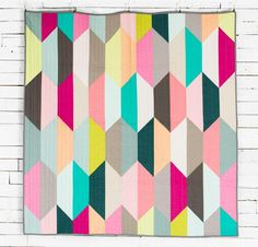 This precut-friendly top adds modern charm to any room with pops of bright and muted color.