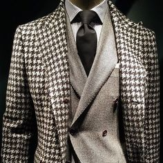 gq: Giant tweeds are on trend at #mfw. This mega-scaled houndstooth coat from @kiton makes a strong style statement when worn over a simple suit. - @jimmooregq