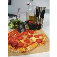 This is amazing for the men who love their food and their bikes. Motorcycle pizza cutter, anyone getting their own place and want to get them a personal funny present :) this is a great gift x