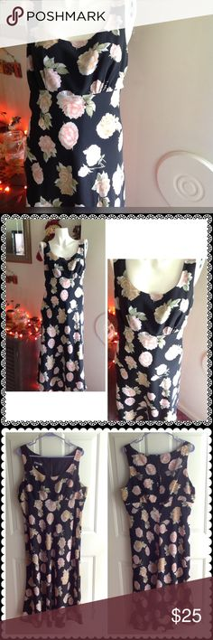 Flirty in Floral Gorgeous big floral pattern on a black base. Gently worn. Size chart and measurements in last photo. Zipper on the side. Button on the back of neck. 🌺 looks great with a black choker. Froxx Dresses