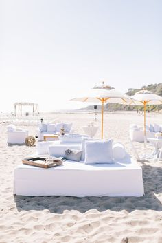Beach wedding reception. Love these sectional couches with pillow. Elegant and casual