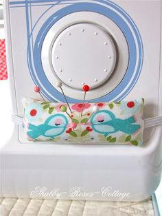 Pincushion attached to sewing machine.  How I wish I would remember to make…