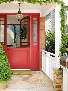 Red Dutch Door in front entrance. With side lights.