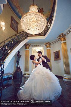 bride and groom portrait chandelier dancing