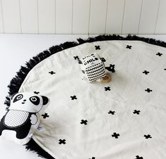 Stunning on trend and modern floor mat in a monochrome colour scheme of black crosses on an off white natural colour with black fringing. Limited
