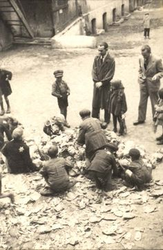 Lodz, Poland, Jews gathering vegetables provided, often rotten, in the ghetto.