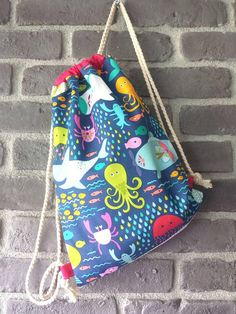 Check out this item in my Etsy shop https://www.etsy.com/uk/listing/610944557/handmade-kids-fabric-backpack-with-cute