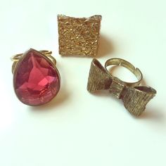 Banana Republic Pink Stone Cocktail Ring (+2 free) Banana Republic pink teardrop stone cocktail ring in size 6. Adding two bonus rings for the buyer, one golden textured square ring (size 6) and one bow ring (adjustable) for free! Banana Republic Jewelry Rings