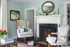 Nantucket Cottage by Gary McBournie -  Palladian Blue walls, striped slipcovers, oval mirror, fireplace