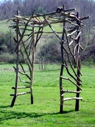 Arbor with red roses or climbing ivy around it to offer some privacy