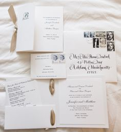 Invitation with collection of vintage stamps. The Miami Bride Guide.