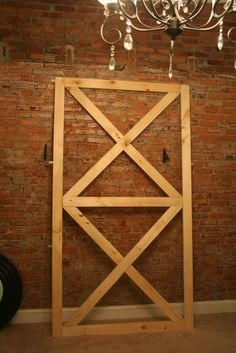 DIY barn door frame and add laminate flooring or bed board to finish the look