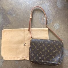 "LV Louis Vuitton Musette Tango purse This is a gorgeous LV bag!  It is in perfect condition!  The strap is adjustable. 10"" across 8"" in length.  Perfect bag for on the go!  You won't be disappointed with this beauty  Louis Vuitton Bags Shoulder Bags"