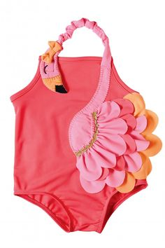 """What's frilly, pretty, and has more grace and style than any other animal in the land?? """"On The Flamingo"""", that's who!!! Having your little one be all the more frilly by flouncing around in this swimsuit that will have her be the most fashionable in the flock!!! Nylon spandex bathing suit features layered flamingo wrap around applique with elastic neckline and mesh bum ruffles."""
