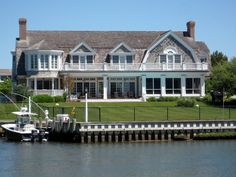 intrigued with this gambrel and use of porches...