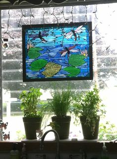 my kitchen sink window - stained glass with grout on a piece of glass in a frame.