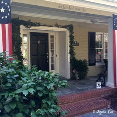 Covered front porch decorated with patriotic flag pennants and bunting for the Fourth of July.