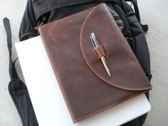 Leather composition notebook cover that locks with the pen.  -Great for college students to set them apart from all the others.  -Fits the standard