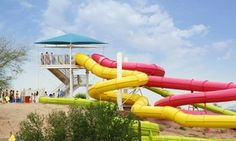 Water-park pass unlocks myriad aquatic amusements, such as near-vertical 35 ft. slides, inner-tube rides, and million-gallon wave pool