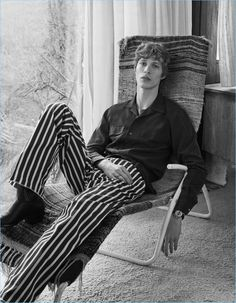 Lounging, Sven de Vries wears a Ralph Lauren Purple shirt with Hilfiger Edition striped pants.