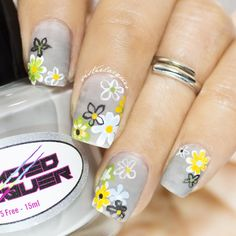 Yellow & Black Flowers on Gray Nails