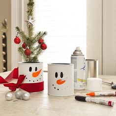 Bring your snowman indoors with this paint can centerpiece! Follow the link in our profile to get the how-to on this and other #DIY holiday crafts. #BuildCheer