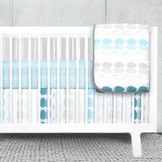 Olli & Lime Forrest Crib Set: Olli & Lime's bumperless three-piece crib set ($195) includes graphic illustrated feather motifs in shades of blue, aqua, gray, and white.