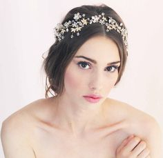 Delphine is a beautiful and sparkly hand beaded gold and silver crystal halo, attached to a slim beige satin ribbon to tie nicely at the back