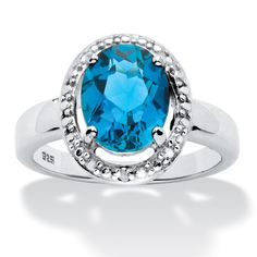 This vibrant beauty is a blaze of blue with a timeless oval-cut genuine London blue topaz surrounded by a diamond accent-Nbw78PC6
