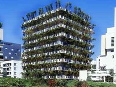 "The ""Flower Tower"" in Paris. A living bamboo screen runs around the entire exterior. A great way to get a little greenery into an urban space."